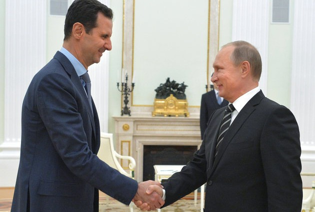 In this photo taken on Tuesday, Oct. 20, 2015, Russian President Vladimir Putin, right, shakes hand with Syrian President Bashar Assad in the Kremlin in Moscow, Russia. President Bashar Assad was in Moscow, in his first known trip abroad since the war broke out in Syria in 2011, to meet his strongest ally Russian leader Putin. The two leaders stressed that the military operations in Syria - in which Moscow is the latest and most powerful addition - must lead to a political process. (Alexei Druzhinin, RIA-Novosti, Kremlin Pool Photo via AP)